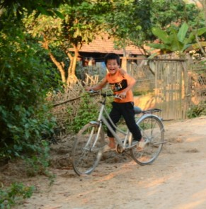 Simples dreams become true: vietnamese children ride a bike to go to school.